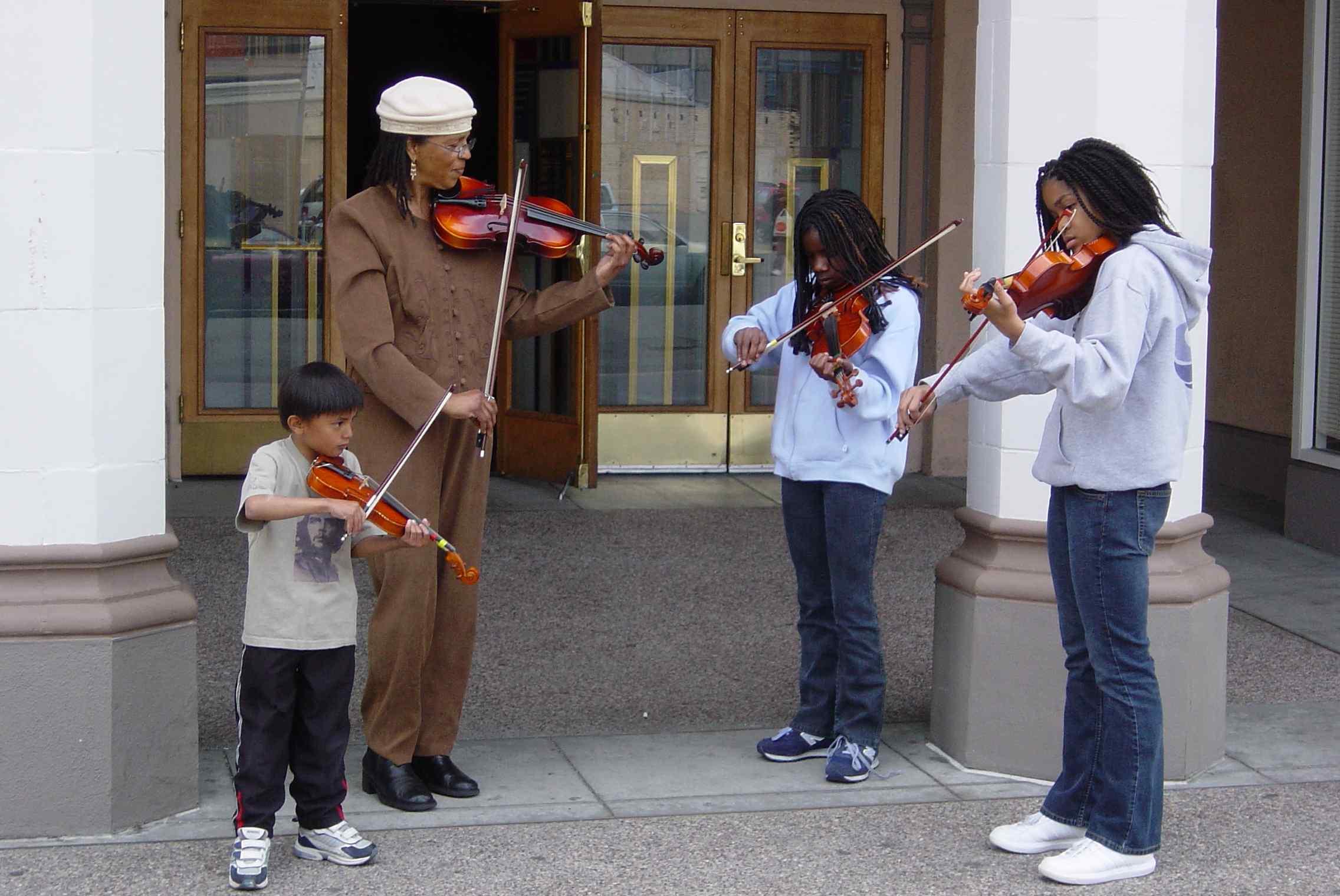 Tarika Lewis and Students Serenading Outside the Malonga Center